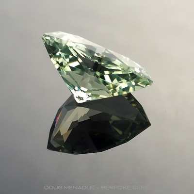 Light Green Sapphire, Shield, Rubyvale, Central Queensland, Australia, 7.60 Carats, 14.66x10.24x7.30mm, #12112-7, A beautiful natural Light Green Sapphire from the Australian sapphire gemfields. Doug Menadue :: Bespoke Gems :: WWW.BESPOKE-GEMS.COM - Finest Precision Custom Gemcutting Based In Sydney Australia