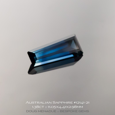 12141-21, Australian Sapphire, Tapered Baguette, 1.38 Carats, 11.05x4.41x2.98mm, Blue With Light Blue Tip - A beautiful natural Australian Sapphire from the gemfields around Rubyvale, Central Queensland, Australia - Doug Menadue :: Bespoke Gems :: WWW.BESPOKE-GEMS.COM - Finest Quality Precision Custom Gemcutting and Lapidary Services Based In Sydney Australia