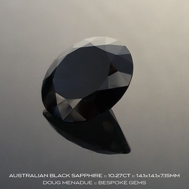 AUSTRALIAN BLACK SAPPHIRE :: 10.27CT :: 14.1X14.1X7.15MM :: This magnificent gemstone is an Australian black sapphire. It is a big stone, eye clean and untreated, just as it came from the earth. The colour of this stunning sapphire is actually a very deep blue, so deep that it becomes what is known as a ''black'' sapphire. It still retains flashes of the deep rich blue colour especially under lights and when viewed in the hand you can see into the stone and note the blue colour. It is not opaque like black spinel or black jade. It is transparent like any other high grade sapphire.  This black sapphire is part of an old time digger's collection that he built over the years and it now being put up for sale. It has been precision cut and polished locally on the gemfields and is a first class sapphire in every regard. For those folks that have a penchant for dark or black gemstones then this is perfect for you and not to be missed as it is a unique black sapphire. It is very hard to get big beautiful sapphires like this regardless of the colour, especially of this size and quality.  http://www.bespoke-gems.com/australian-sapphires.php#image_203132  DOUG MENADUE  WWW.BESPOKE-GEMS.COM  SYDNEY CBD AUSTRALIA - Precision Gemcutting and Lapidary Services Located In Sydney Australia