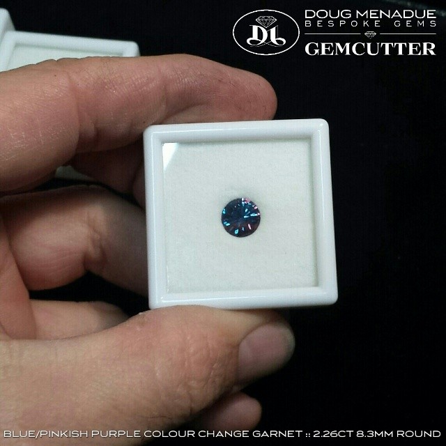 Any one interested in a BLUE/PINKISH PURPLE COLOUR CHANGE GARNET :: 2.26 CT :: 8.3MM :: MADAGASCAR.  This gem exhibits a very strong colour change and the blue is dynamite! It has been well cut (not by me) in a round design.  It is an excellent size. Priced at $1100 USD per carat.  Contact me if you are interested :: dmenadue@yahoo.com  WWW.BESPOKE-GEMS.COM - Precision Gemcutting and Lapidary Services Located In Sydney Australia