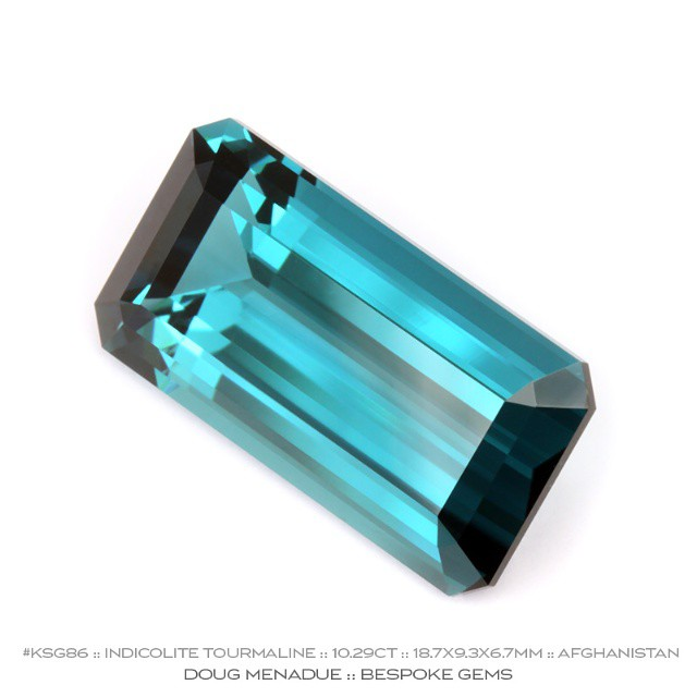 KSG86 :: INDICOLITE TOURMALINE :: 10.29CT :: 18.7X9.3X6.7MM :: AFGHANISTAN :: EMERALD CUT :: One from the collection :: Here is truly a rare and precious gem. An eye clean blue indicolite tourmaline exceptional in every regard. The color is superb and it has been crafted by an Australian gemcutter so you know the quality of the faceting and the finish of the polish is first class. The design is the classic Emerald Cut and this gem would be prefect as a ring halo set with diamonds.  Available for sale :: Contact me either via PM or email at dmenadue@yahoo.com  WWW.BESPOKE-GEMS.COM - Precision Gemcutting and Lapidary Services Located In Sydney Australia