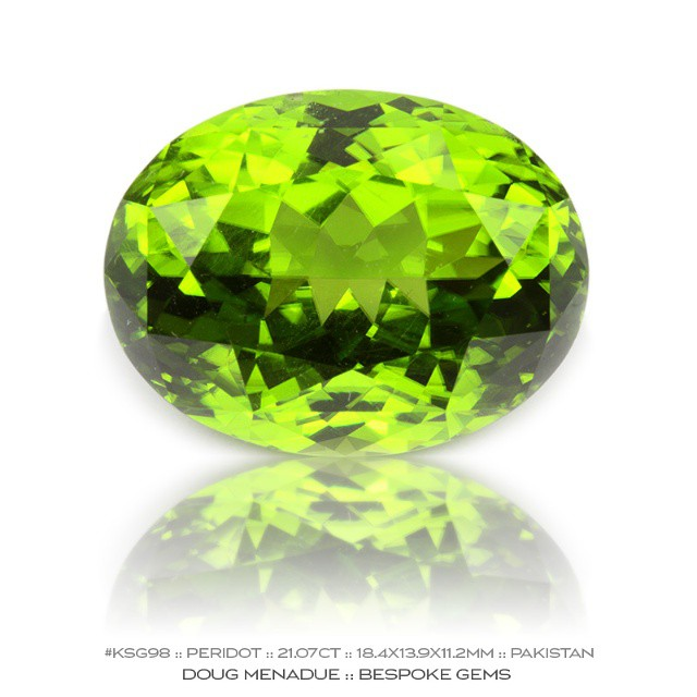 KSG98 :: PERIDOT :: 21.07CT :: 18.4X13.9X11.2MM :: PAKISTAN :: An awesome piece of green goodness. This is a very fine peridot from Pakistan which is considered to be among the finest peridot in the world. The colour is ideal and a top green. It is big and beautiful and simply devine.  Available for sale.  Contact via PM or email dmenadue@yahoo.com  WWW.BESPOKE-GEMS.COM  SYDNEY :: AUSTRALIA - Precision Gemcutting and Lapidary Services Located In Sydney Australia
