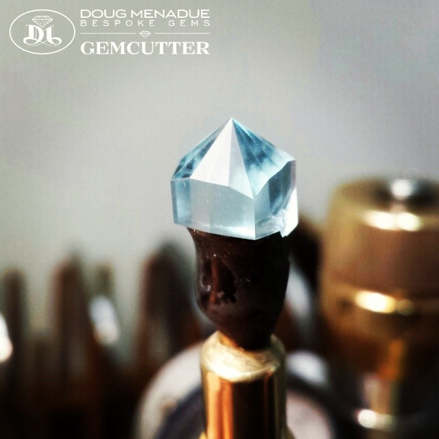 The sky blue topaz NIGERIAN CUSHION is starting to take shape. Its a beautiful piece of rough.  WWW.BESPOKE-GEMS.COM - Precision Gemcutting and Lapidary Services Located In Sydney Australia
